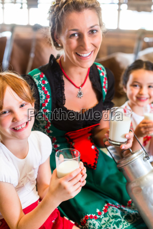 bavaria family drinking milk in cowshed