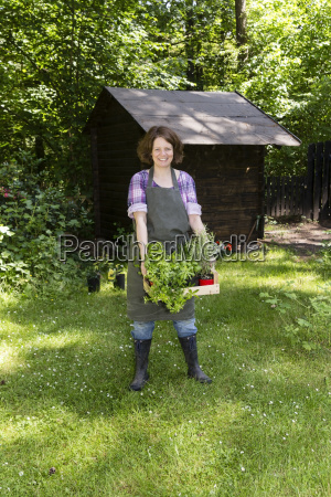woman with herbs in the garden