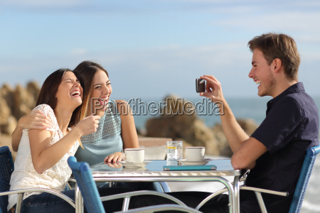 friends laughing and taking photo with