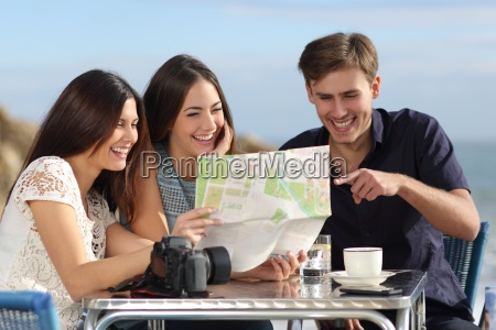 group, of, young, tourist, friends, consulting - 13941287