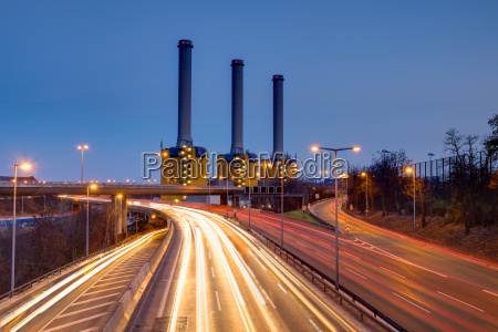 power plant and highway at night
