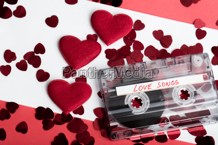 audio cassette tape on red backgound