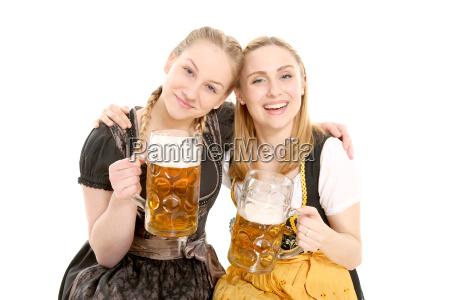 girlfriends in garb with beer jug