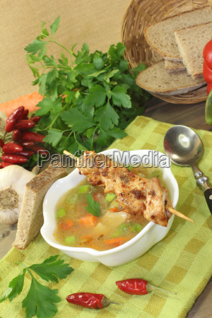 poultry consomme with chicken skewer