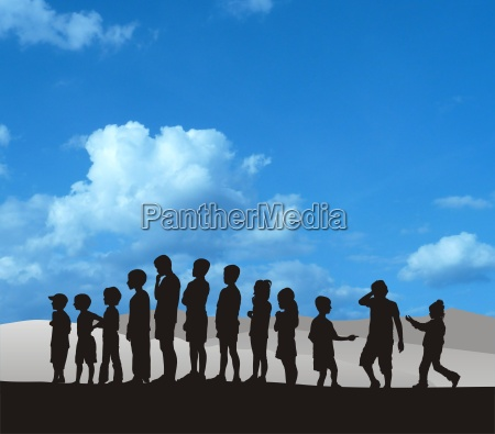 standing silhouetted children