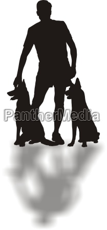 man standing with two dogs
