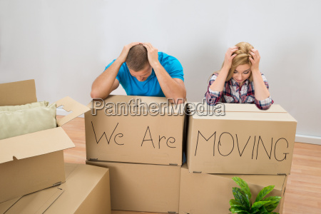 stressed couple in new home