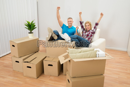excited couple in new home