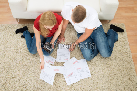 couple with bills and calculator