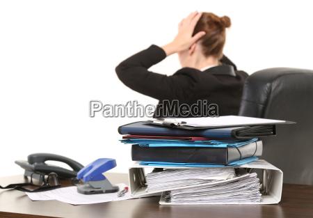 woman desperately in office