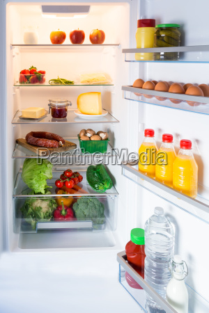 opened refrigerator filled with food