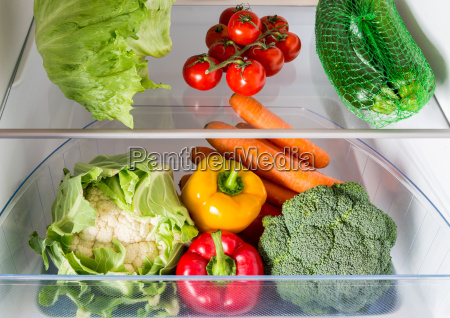open refrigerator filled with fruits and