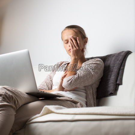 very tired young woman burning the
