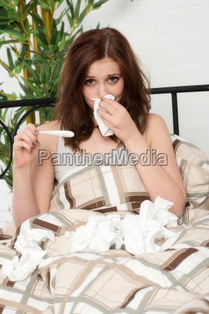 young woman lying with fever and