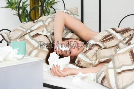 young, sick, woman, lying, in, bed - 13972829