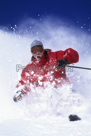 man downhill skiing in utah on