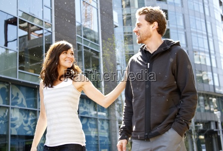 a man and woman walking in