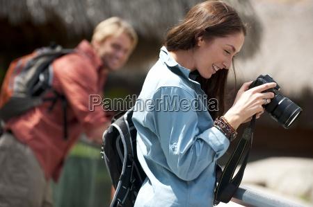 a couple take photos in everglades