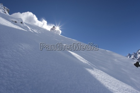 a skier carves in perfect powder