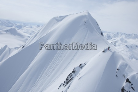 two skiers on a snowy mountain