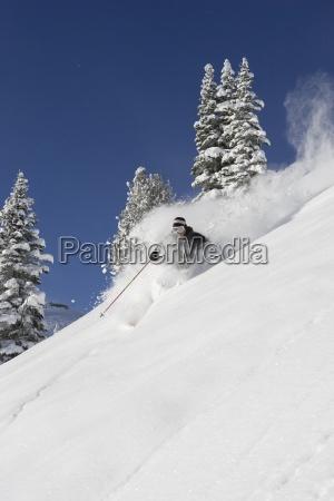 male skier skiing powder in washington