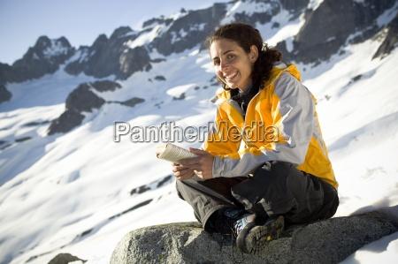 a latina woman reads a book