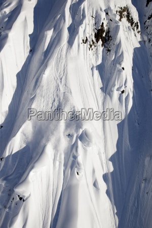a male extreme skier skis a