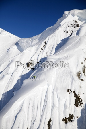 a male skier skis a big