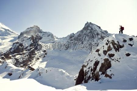 a skier posing on heliotrope ridge