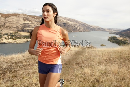 an athletic female jogs on a
