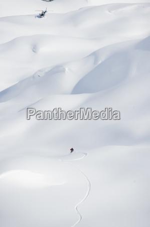 a skier makes his way down