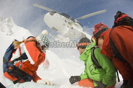 a group of skiers watch as