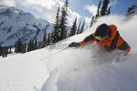 a young man skier skis the