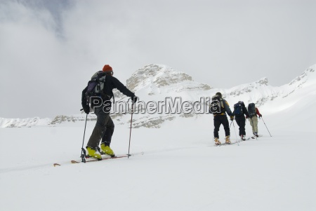 skiers tour in the backcountry of
