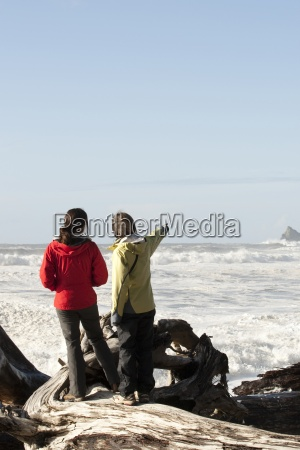 two woman looking out over the