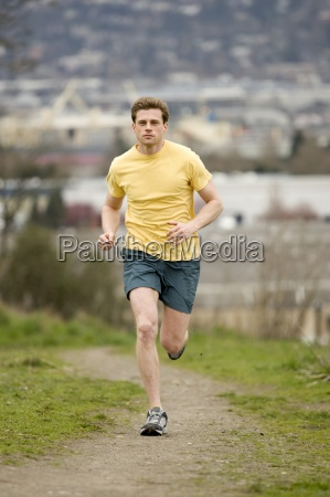 an athletic man jogging along a