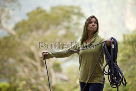 a woman prepares her rope for