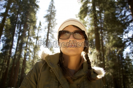 woman in sunglasses looks down at