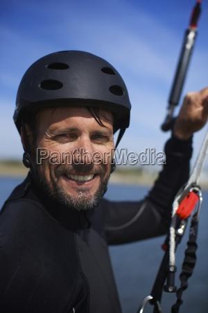kitesurfer male around 40s looks at