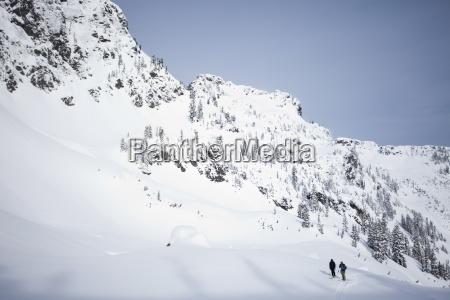 two skiers in the backcountry on
