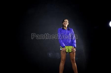 female runner laughs in san diego