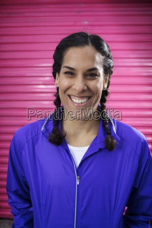 young female runner wearing braids and