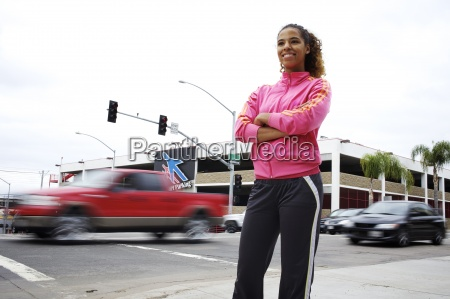 a female runner stands on the