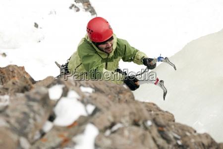 a man ice climbing
