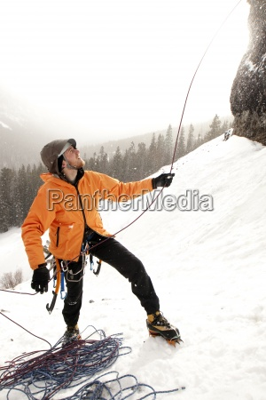 a man flaking rope after a