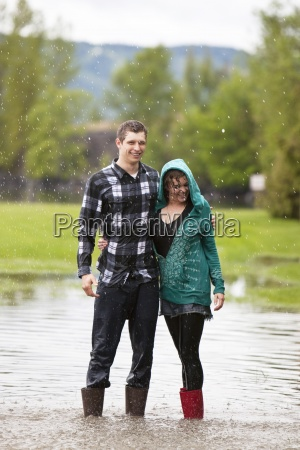 a young couple stands in a