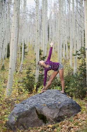 a young woman performs a yoga