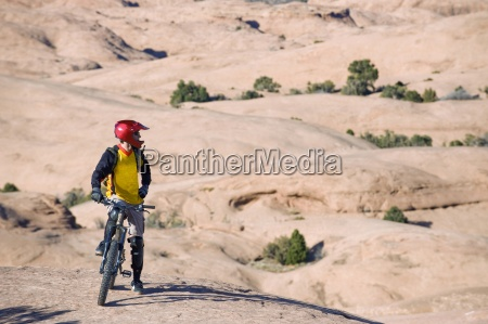 a mountain biker rests during a