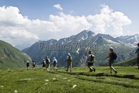 a group of hikers trek across