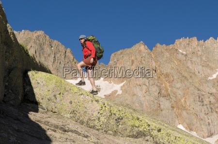 a, woman, hiking, near, upper, sunlight - 13975203